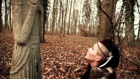 Beautyful Viking woman conjures up an ancient sculpture Footage