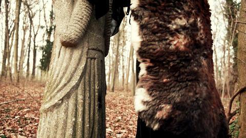 Beautyful Viking woman conjures up an ancient sculpture Live Action