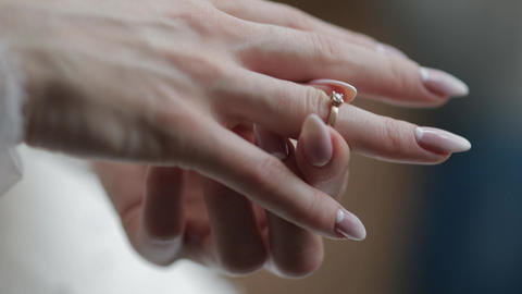 Elegant blonde bride wear beautiful engagement ring. Woman at wedding morning Live Action