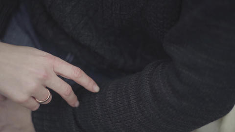 Woman hand with the gold ring on her finger close up. Two fingers walk on the Footage