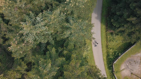 Young couple together walk in the park. Summer weather. Shooting from the air Footage