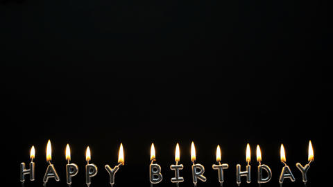 Happy Birthday candles on black background Live Action