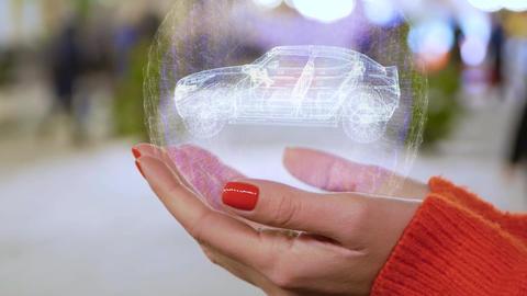 Female hands holding hologram modern Suv Live Action