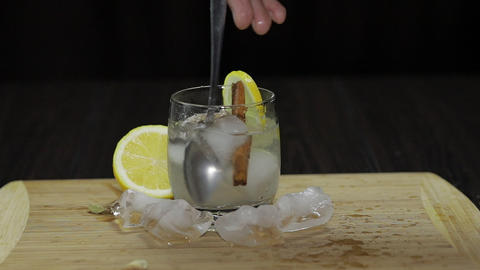 Mix with a spoon lemon cocktail. Refreshing alcoholic cocktail drink Footage