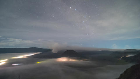 Misty volcanic Mount Bromo timelapse clip view from night till sunrise, Indonesia Footage