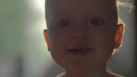 Portrait of smiling little girl with big blue eyes Footage