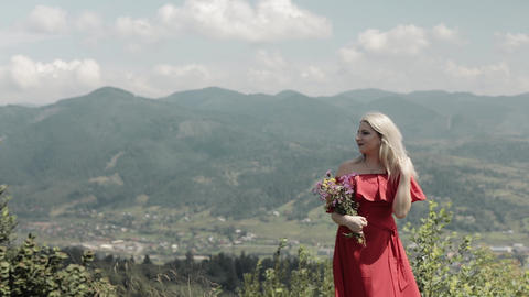 Beautiful and lovely woman on the mountain. Pretty and well-groomed woman Footage
