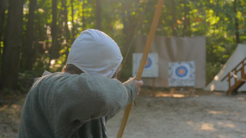 Male archer with wooden bow Live Action