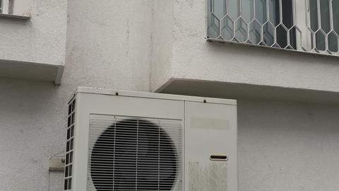 Air conditioner outside unit near apartment window ビデオ