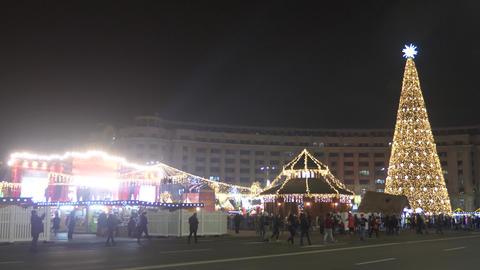 Christmas market with big christmas tree Archivo