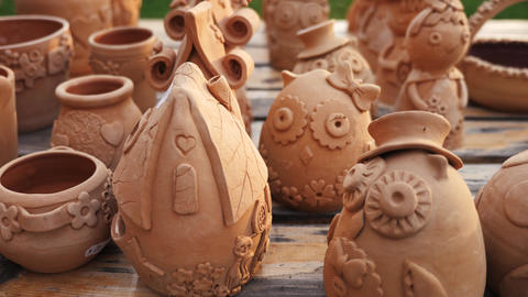 Clay pot figurines at the market Footage
