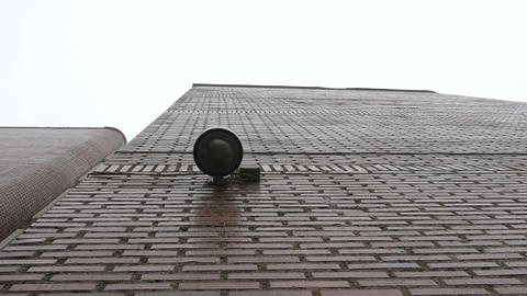 Dome surveillance camera on the school building recorded from below Footage