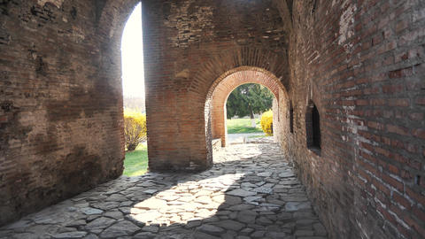 Old roman brick building walls with paved rocks Footage