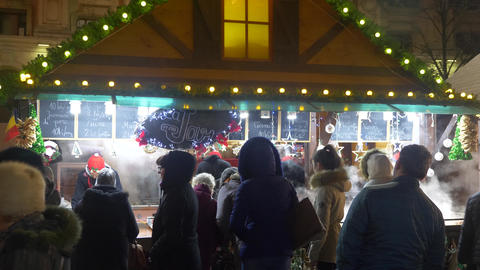 People buying food at christmas market Footage