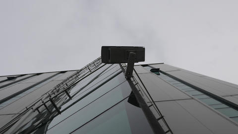 Surveillance camera recorded from below on the modern office building Footage