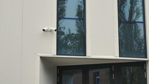 Surveillance cameras above the building entrance door Footage