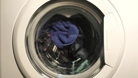 Washing machine washing clothes close up Footage