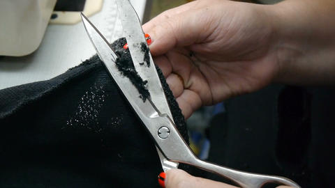 Closeup of tailor. Woman cutting the thread and sewing with a sewing machine Live Action