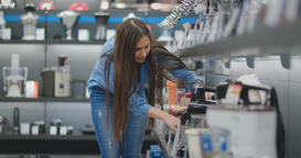 In the appliances store, the kitchen appliances woman chooses a blender in her Footage