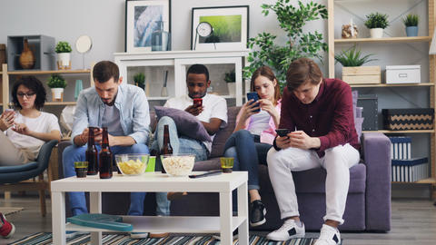 Millennials using smartphones at home enjoying social media surfing the internet Live Action