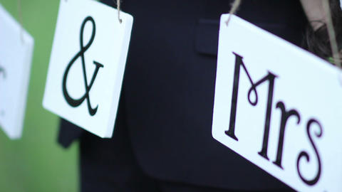 bride and groom hold Wedding tablets with the letters Mr and Mrs GIF