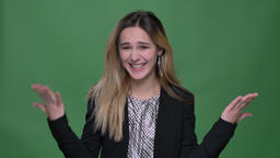 Closeup shoot of young attractive hipster caucasian female jumping from joy and Footage