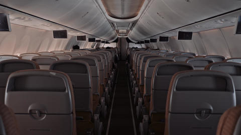 Backside view modern large airliner passenger cabin people rest and watch tv Archivo
