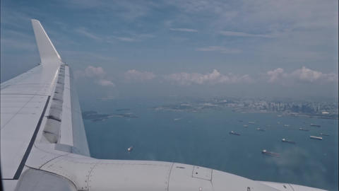 airplane fly above the tropical island, View through an airplane window Archivo