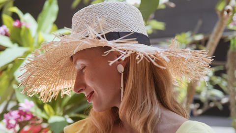 Portrait of beautiful young woman with straw hat on a... Stock Video Footage