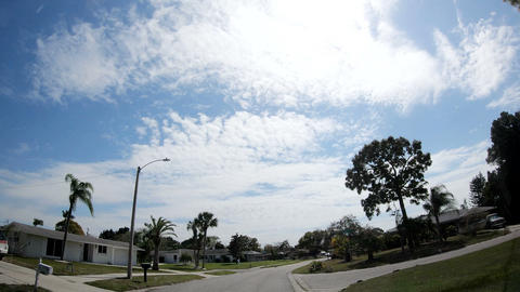 Florida, USA - February 2019: driving on a quiet neighborhood on a cloudy day Footage