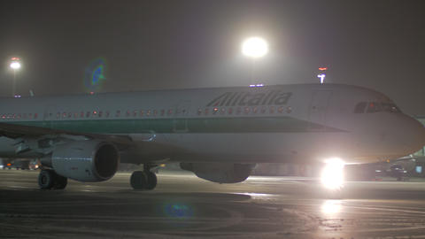 Taxiing aircraft of Alitalia in Sheremetyevo Airport at night, Moscow Footage