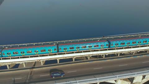 Subway train ride over bridge crossing river Footage