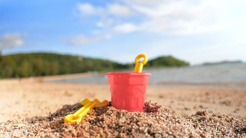 Toys on the sand beach with sea wave select focus shallow depth of field with summer atmosphere Footage