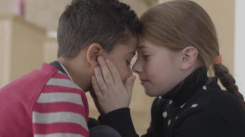 Portrait of cute adorable african american boy and pretty blond caucasian girl Footage