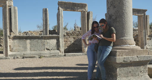 Watching museum travel guide in Ancient city Perge, open air antique historical Live Action