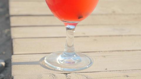 Refreshing orange cocktail on beach table Footage