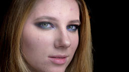 Closeup shoot of young beautiful female face with beautiful makeup with Footage