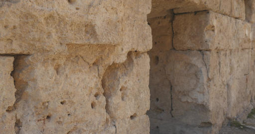 Walking through ancient arch in the wall in Ancient city Perge, open air antique Live Action