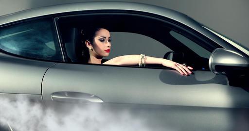 Fashion Model Posing In A Car GIF