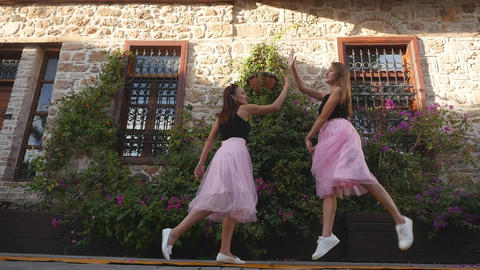 Fashion lifestyle two young women in tulle skirt funnily meet each other Footage