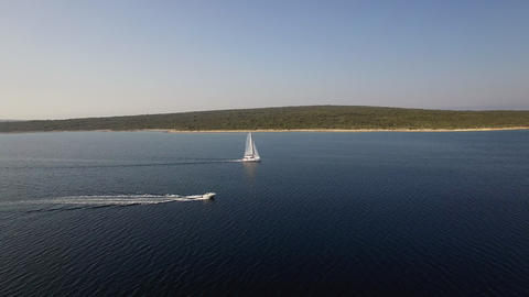 Aerial - Cruising speedboat and catamaran near the coast Footage