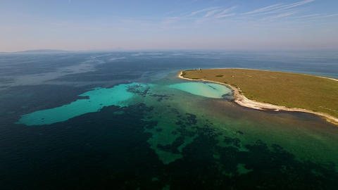 Aerial - Decay of algae during algal blooms at small sea island Live Action