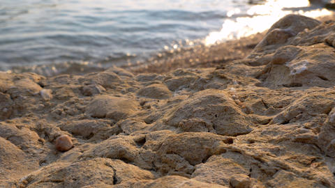 Closeup - Sandy rock eroded in a beach at sunset Stock Video Footage
