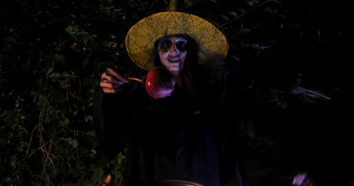 Wicked Witch show enchanted apple in Halloween Horror Scene Live Action