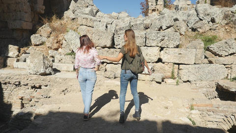 Walking with map in Ancient city Perge, open air antique historical museum Live Action