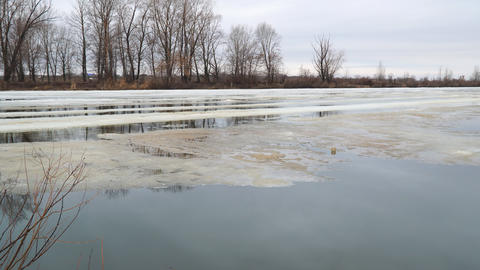 Melting the last ice on the river in early spring on a cloudy day Footage
