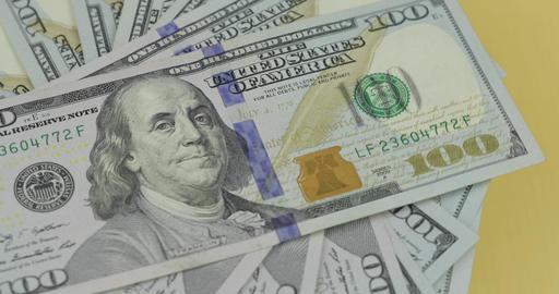 Hundred american dollar bills spinning. Close-up. Background with dollar bills Archivo