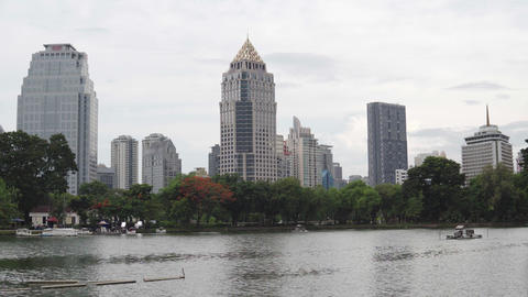 Calm cityscape at the daytime in summer. Ripples on the water on the city lake Archivo