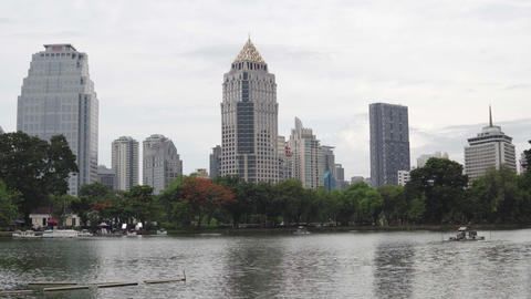Tall buildings on the waterfront of the city lake in the downtown. Calm scene Footage