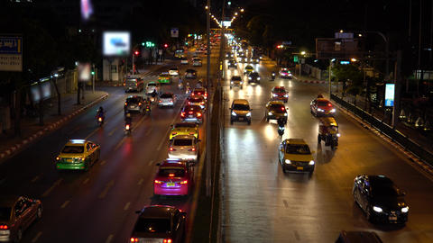 Crossroads traffic jam at night time. Busy car traffic on the crowded street in Live Action